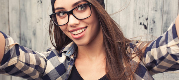 Girl in glasses with braces